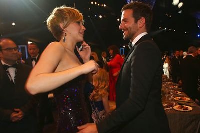 Jen dropped multiple F-bombs at <i>American Hustle</i> co-star Bradley Cooper in the press room of the SAG Awards!
