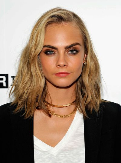 <p>After uploading a cryptic Instagram post hinting at a new look, Cara Delevingne has finally debuted a fresh cut at Comic Con. Ditching her trademark dark blonde lengths, Delevingne opted for a laid-back wavy bob in a significantly lighter shade than usual.&nbsp;</p> <p>She's not the only one who's decided to mix it up either; click through to find your perfect A-list hair inspiration, from Mila Kunis' short 'do to Emma Roberts' platinum mane.</p>