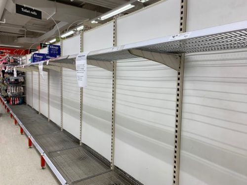 Empty shelves pictured at a Coles store as toilet paper shortages continue.