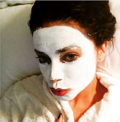 Model Adriana Lima masking up.