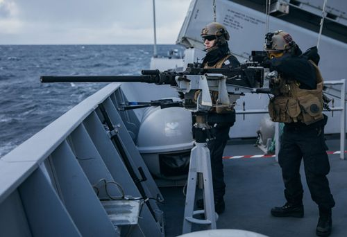 Norwegian naval gunners practice firing during the military drills.
