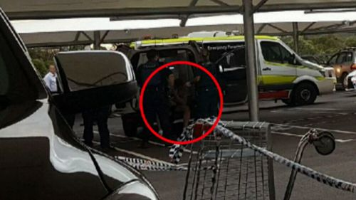 Police drew their Tasers before the suspect allegedly rammed their cars. (9NEWS)