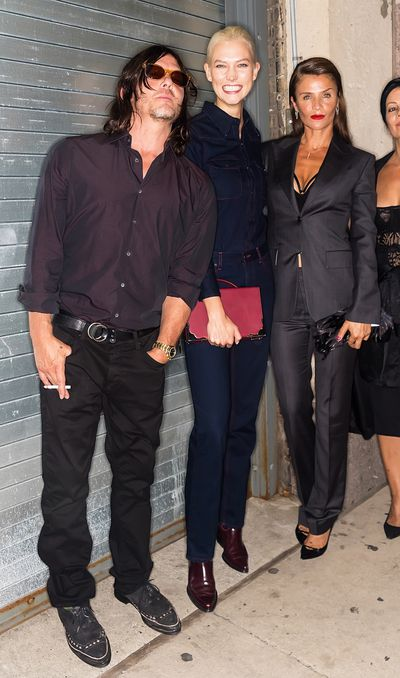 <p>Walking Dead star Norman Reedus and his ex-partner Helena Christensen (with supermodel Karlie Kloss squeezed in between) were on hand to support their son Mingus Reedus, making his runway debut at Calvin Klein.</p> <p>&nbsp;</p> <p>&nbsp;</p>