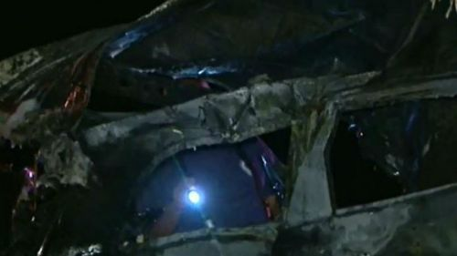 Onlookers pulled the driver to safety, before the car burst into flames. (9NEWS)