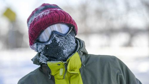 Authorities warn people should keep their faces covered while travelling outside, like this person in Minnesota.