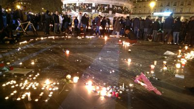 Tributes and candles at the Place de la Republique. (Jack Hawke, 9News.com.au)