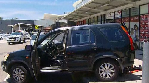 The driver, thought to be in his 70s, was allegedly backing out of a carpark at Bonnyrigg Plaza. (9NEWS)