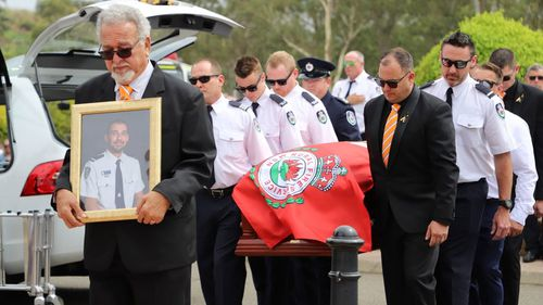 Daughter Of Volunteer Firefighter Dons Dad's Helmet At His Funeral