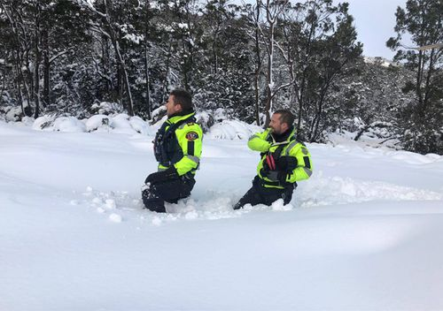 Two search and rescue team members plough through deep snow in Tasmania hunting for missing hiker Michael Bowman. Three police search and rescue teams, the Westpac Rescue Helicopter, a police marine vessel and a team of SES volunteers, are currently searching for the 57 year old Victorian man, who is an experienced bushwalker.