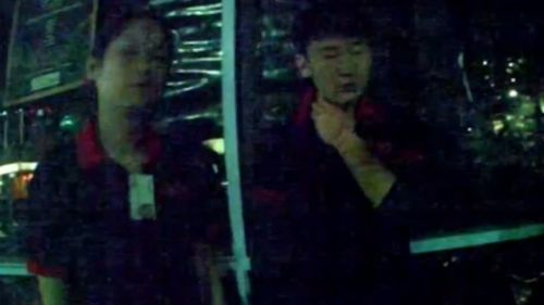 Mr Kong (right) in the moments after the incident last June. (9NEWS)
