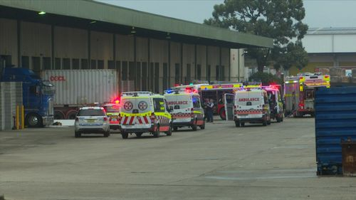 A man has been killed at a warehouse in Sydney's south-west after a car crashed into a stationary trailer.