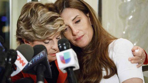 Lawyer Gloria Allred embraces Karena Virginia. (AP)