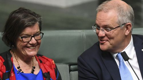 Australian Prime Minister Scott Morrison speaks to Independent MP Cathy McGowan during division in the House of Representatives at Parliament House in Canberra.