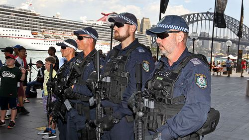 Police armed with M4 rifles will be patrolling the CBD. (AAP)