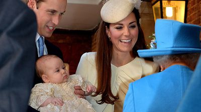 Prince William holds Prince George as they and Duchess Kate are greeted by the Queen. (Getty)