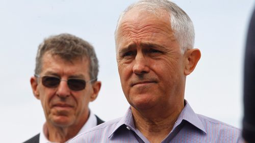 Australian Prime Minister Malcolm Turnbull and Professor Ian Fraser (left) address the media during a press conference at North Bondi Surf Life Saving Club, Sydney. (AAP)