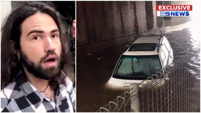 'You idiot': Moment tourist drives straight into floodwaters