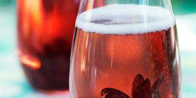 Prosecco with hibiscus flowers