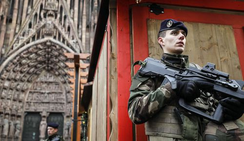 French soldier of France's anti-terror 'Vigipirate' plan, dubbed 'Operation Sentinelle' patrols next to Notre-Dame cathedral of Strasbourg