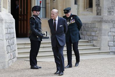 Prince Philip flanked by Assistant Colonel Commandant, Major General Tom Copinger-Symeas (L) inspects buglers during the transfer.