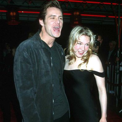Jim Carrey arrives with girlfriend, actress Renee Zellweger at the Los Angeles Premiere of Man on the Moon in December 20, 1999.