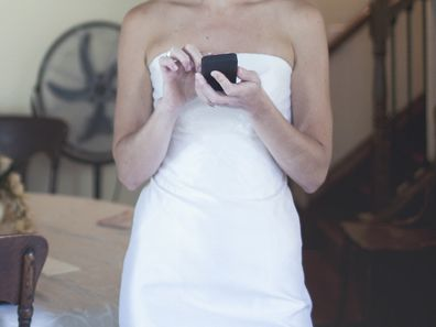 Bride sending text messages ahead of wedding