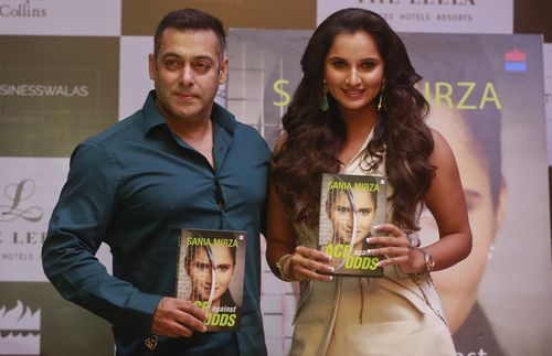 Indian tennis player Sania Mirza, right and Bollywood superstar Salman Khan pose during the release of Sania's autobiography 'Ace Against Odds' in 2016. (AAP)