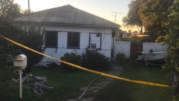 A Wollongong woman, 33, is in a critical condition after firefighters across the Illawarra worked to rescue her from a house fire.