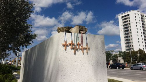 Six crosses are placed at a memorial on campus at the Florida International University last Saturday. (AAP)