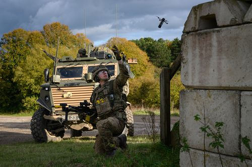 A British soldier launches a DefendTex D40 under-slung grenade launcher drone during a training exercise.