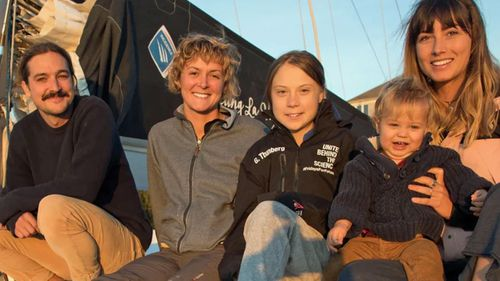 Greta Thunberg with the Australian family who took her to Lisbon and British sailor Nikki Henderson.