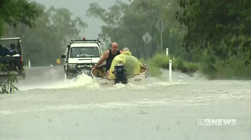 Roads have been cut off and many homes are affected by flood waters in Queensland's north.