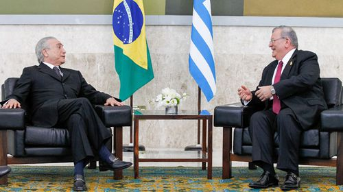 Brazilian presidency showing Brazilian President Michel Temer (L) talking to Greek ambassador to Brazil, Kyriakos Amiridis. (AFP)