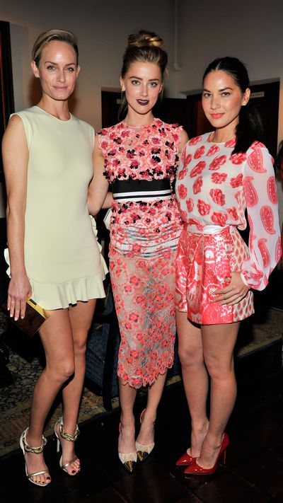 <p>With Amber Valletta and Olivia Munn in Giambattista Valli.</p>