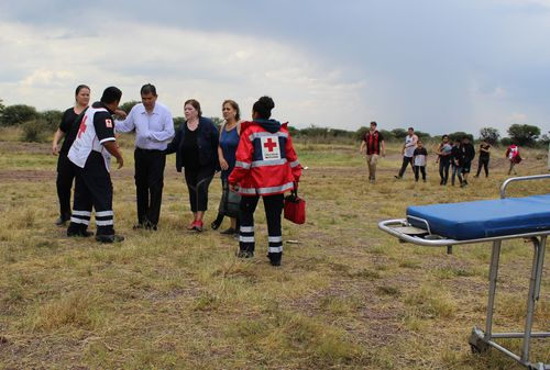 Passengers miraculously walking away from the wreckage of the Aeromexico plane alive, and on foot. Picture: AAP