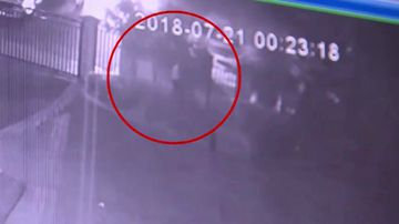 The alleged driver was caught on CCTV jumping over the fence of a gated complex. Picture: Supplied