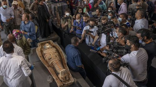 Egyptian antiquities officials on Saturday announced the discovery of at least 100 ancient coffins, some with mummies inside, and around 40 gilded statues south of Cairo.