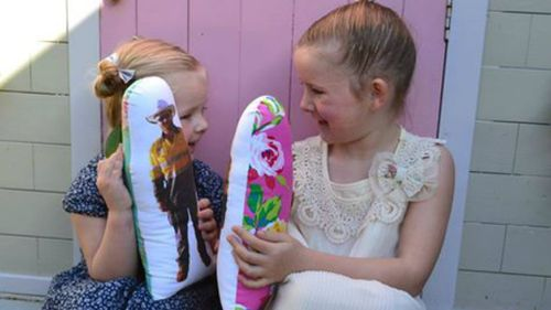 Andie and Lily Martin with their Wish U Were Here dolls made by their mother Lauren. (Supplied)
