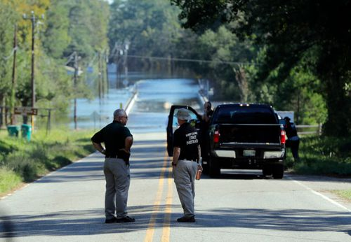 Sheriff's deputies at the scene where two women died while being transported in a police van in South Carolina.