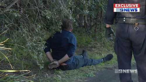 Officers knocked the main aggressor off his bike and handcuffing him on a nearby bike track. Picture: 9NEWS