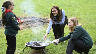 Kate, the Duchess of Cambridge toasts marshmallows with cubs during a visit to the 12th Northolt Scouts in West London, Tuesday September 29, 2020