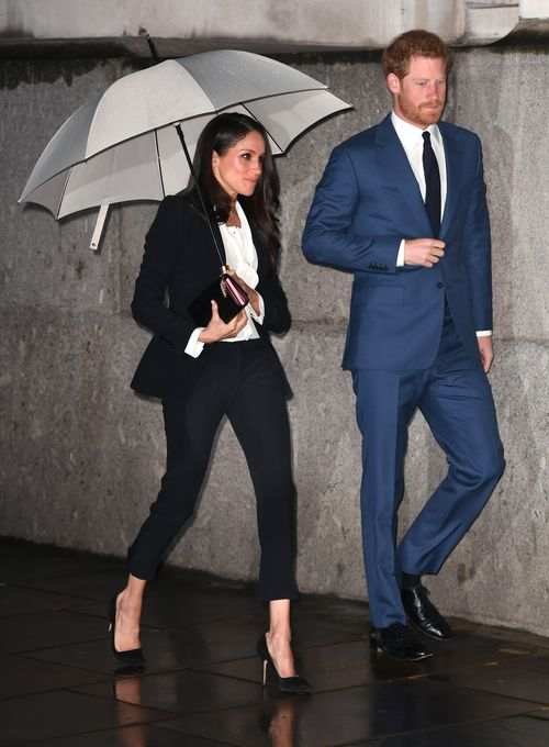 It was raining as the couple arrived at the event. Picture: AAP