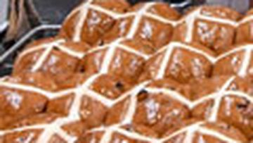 Stock photo of tray of hot cross Easter buns.
