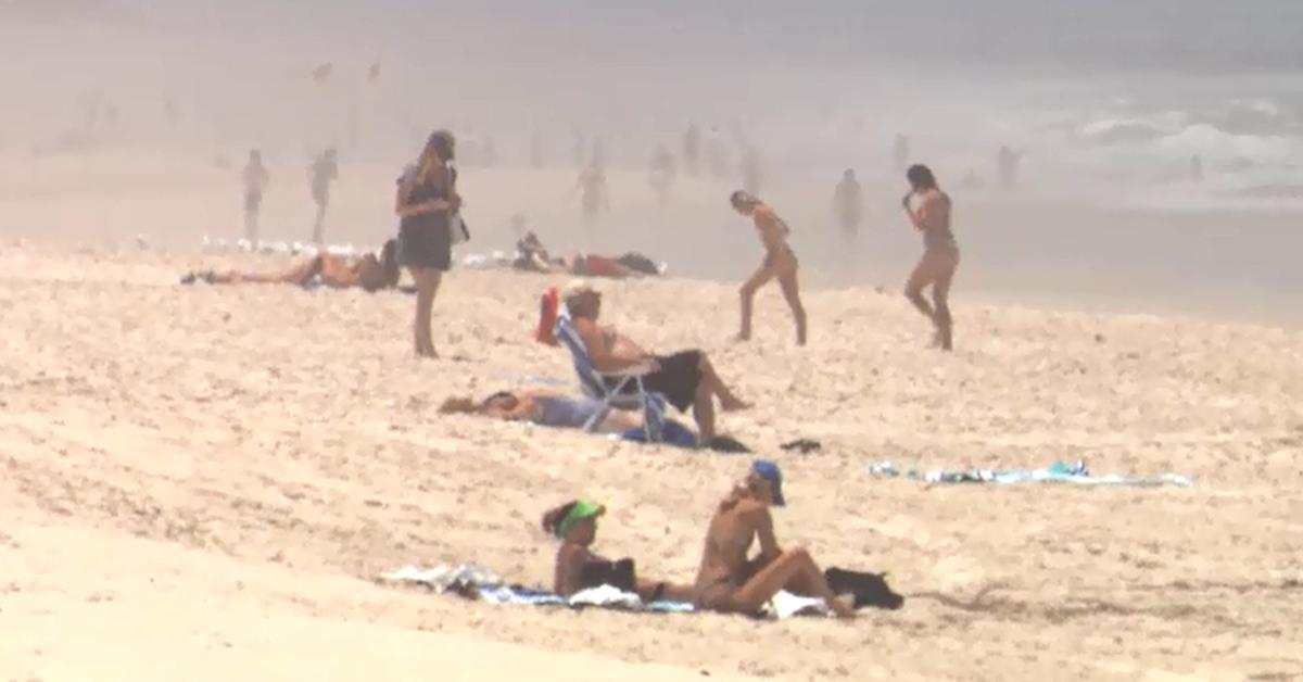 Temperature records broken as Queensland heatwave peaks – 9News