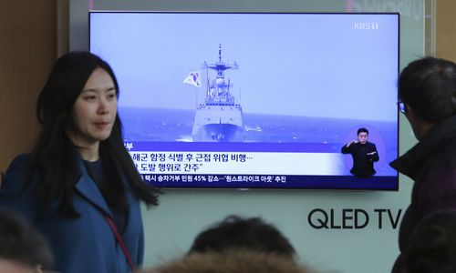 "A TV screen shows file footage of a South Korean warship during a news program at the Seoul Railway Station in Seoul, South Korea, Wednesday, Jan. 23, 2019. South Korea's military accused Japan of a ""clear provocation"" over what it said was a threatening low-altitude flight by a Japanese patrol plane over a South Korean warship on Wednesday."