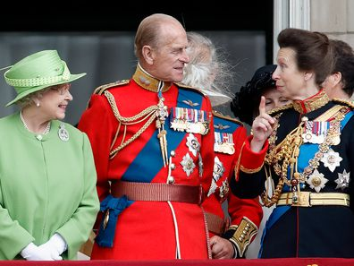 Queen Elizabeth II, Prince Philip, Duke of Edinburgh and Princess Anne, Princess Royal watch a flypast from the balcony of Buckingham Palace during the annual Trooping the Colour Parade on June 16, 2007 in London, England. Trooping the Colour is an annual ceremony, believed to have first been performed during the reign of King Charles II. The parade marks the official birthday