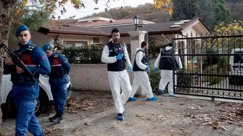 Officers collect evidence from a Turkish villa.