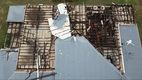 Drone footage shows the devastation the freak storm wrought on houses at Mount Mitchell.