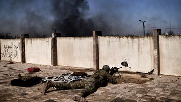 A sniper fires at targets during clashes with Islamic State (IS) group fighters in Mosul on March 5, 2017, during an offensive to retake the western parts of the city from the jihadists.