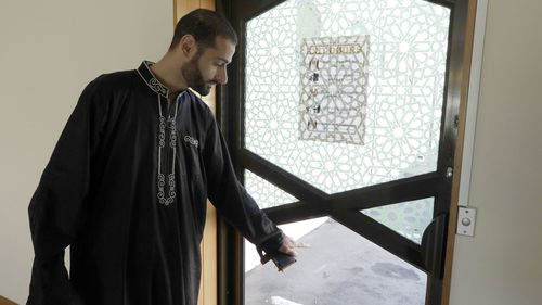 Al Noor mosque volunteer Khaled Alnobani explains his escape through a glass door panel when a gunman burst into the mosque on March 15.